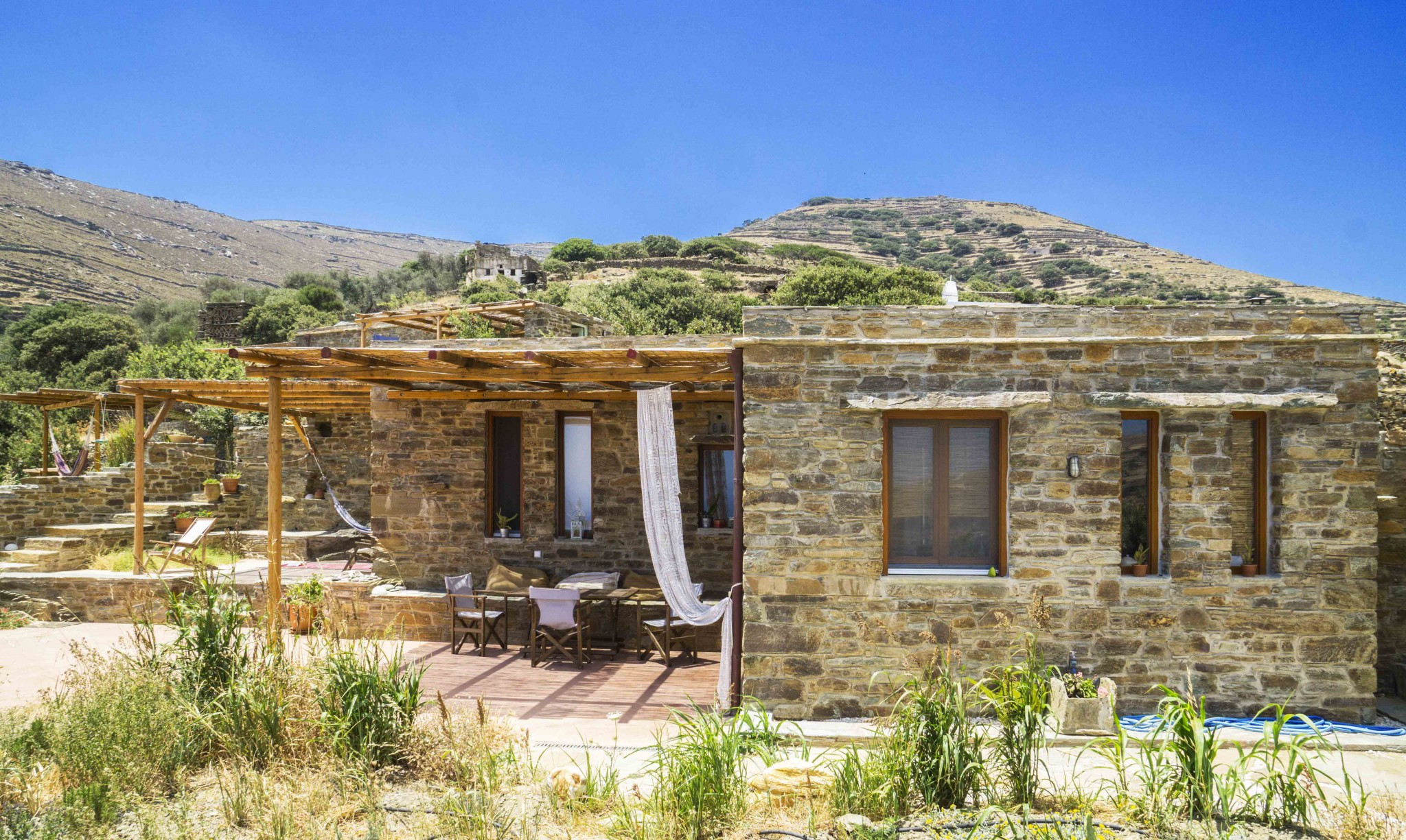 The big stone house tinos eco lodge for House of granite and marble