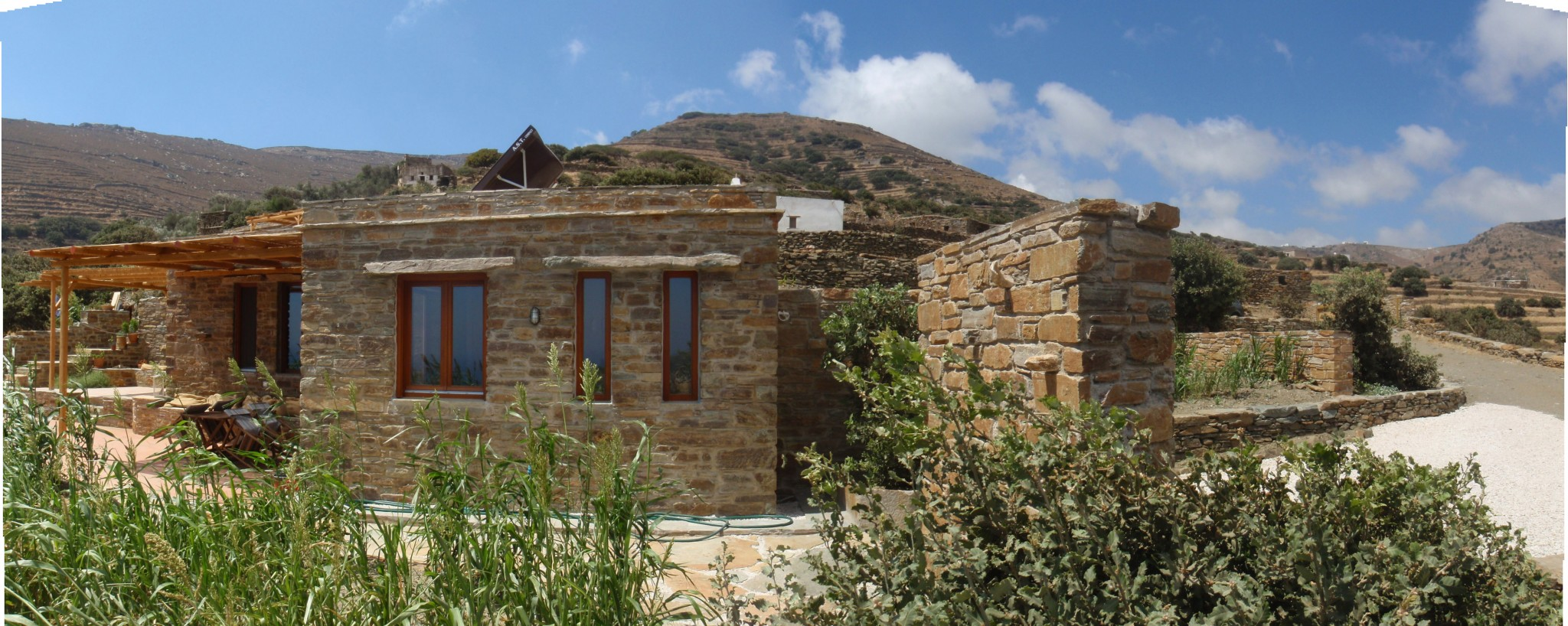 The big stone house tinos eco lodge for Cobblestone house